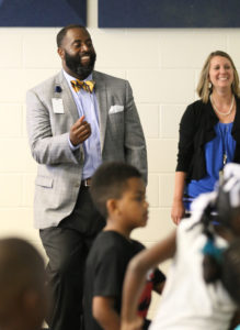 Baron Davis with children and teacher
