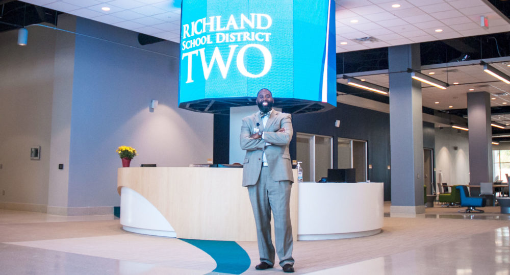 Baron Davis stands in front of Richland 2 digital sign