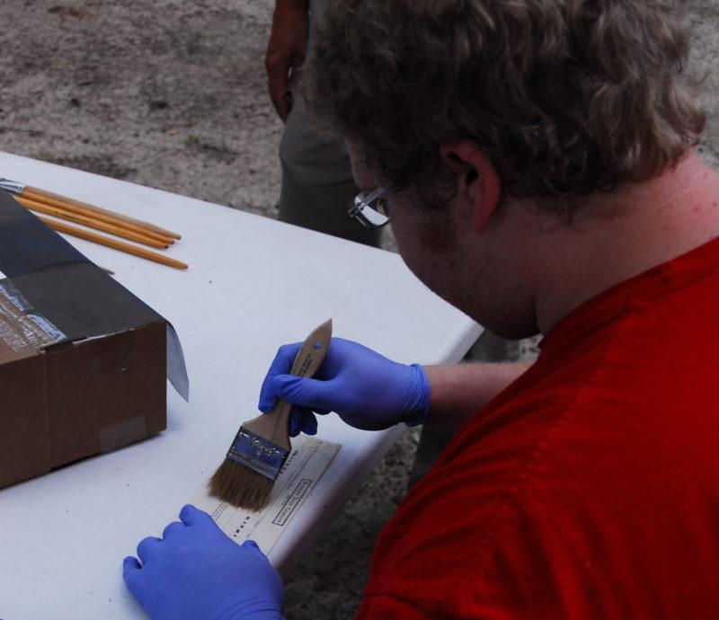 Corey Parker, student, cleans found item