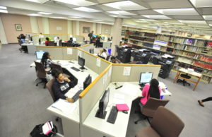 Wide shot of library computers with students