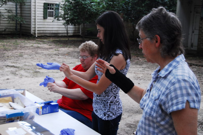 Dr. Lynn Hanson and Students prepare to clean and examine items
