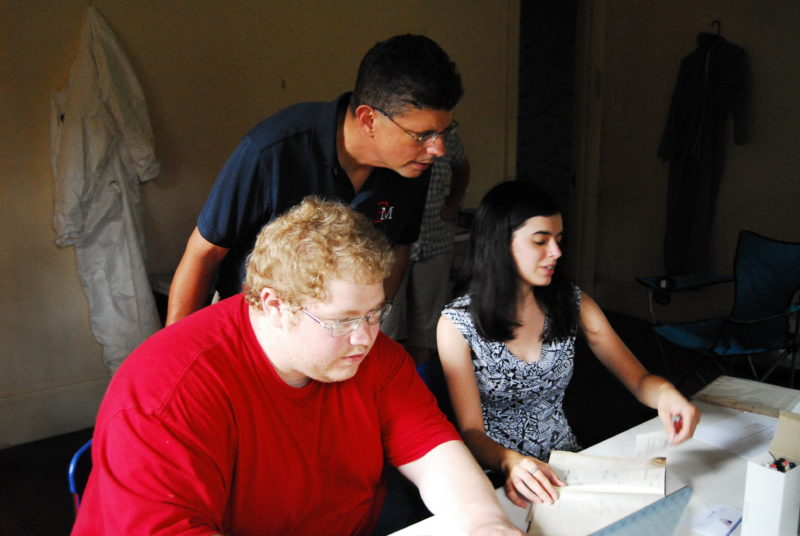 Dr. Kennedy and students sort thorough items