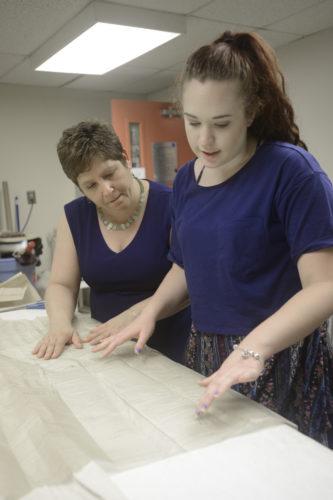 Allison Steadman assists a student
