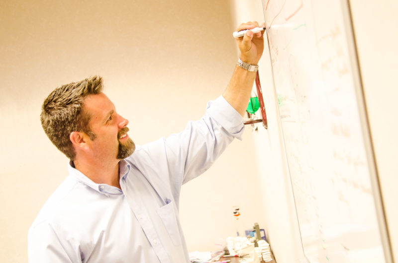 Rob Ardis working at white board