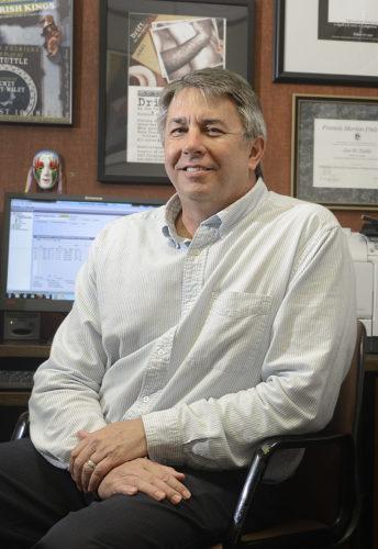 Jon Tuttle in his office