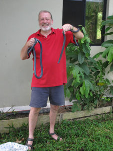 Dr. Jeffrey Camper holds two caecilians